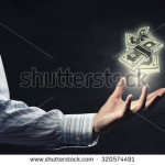 stock-photo-close-up-of-male-hand-holding-dollar-banknotes-320574491