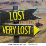 stock-photo-lost-very-lost-signpost-in-a-desert-background-358952147