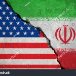 stock-photo-iranian-flag-on-broken-wall-and-half-usa-united-states-of-america-flag-crisis-trump-president-and-570899827 - 010518